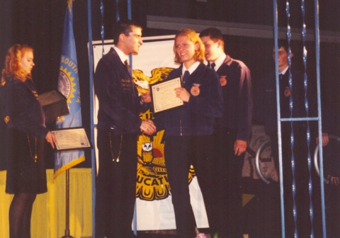 Me receiving something for FFA in my dad's old jacket once I finally came around