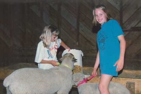 Me showing my cousin how to feed the lambs.